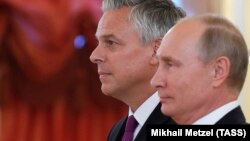 Russian President Vladimir Putin (right) and the new U.S. ambassador to Russia, Jon Huntsman, attend a ceremony during which Putin receives diplomatic credentials from foreign ambassadors at the Kremlin on October 3.