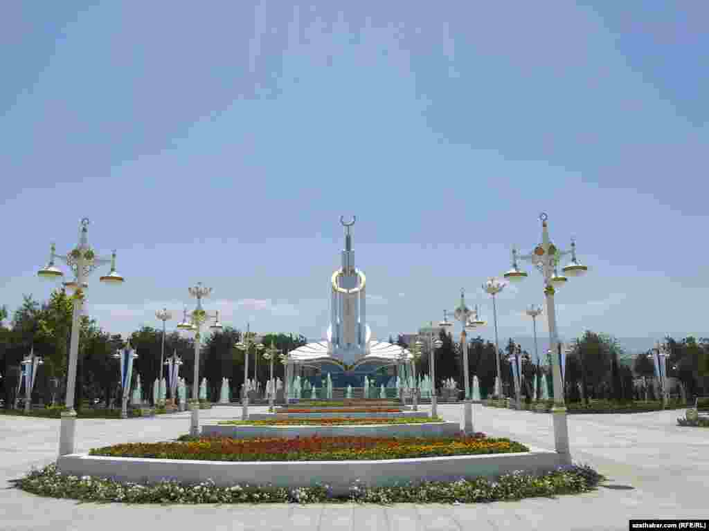 """Turkmenistan. View to the new monument """"Ak saherim"""". Flowers. May 26, 2014"""