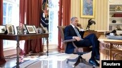 АҚШ президенті Барак Обама Ақ үйде отыр. Вашингтон, 17 желтоқсан 2014 жыл.