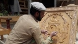 Nuristani woodcarving is now extended to making emblems and other contemporary artifacts for profit.