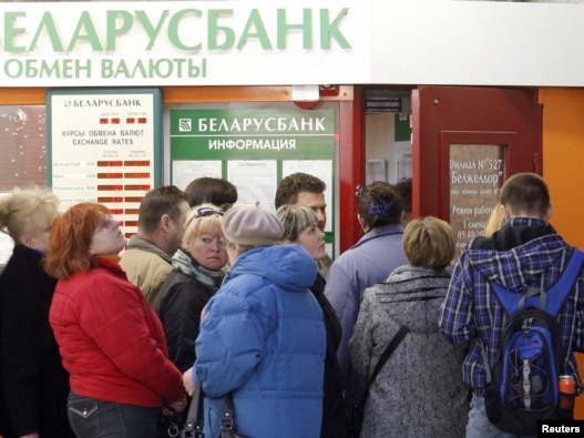 People line up to buy foreign currency outside a bank's exchange office in Minsk on April 6.