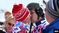 Russia -- Alena Zavarzina and Vic Wild of Russia kiss after the Snowboard Parallel Giant Slalom races at Rosa Khutor Extreme Park at the Sochi 2014 Olympic Games, 19 February 2014