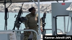 U.S. Navy personnel prepare at a patrol boat to carry journalists to see damaged oil tankers during a trip organized by the Navy for journalists, near Fujairah, June 19, 2019