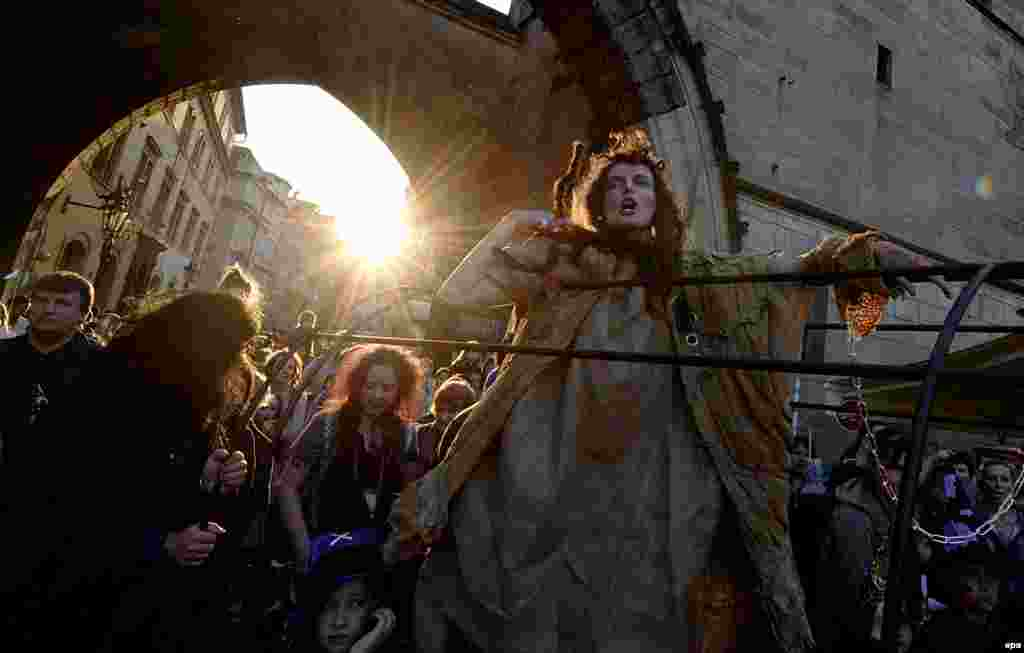 A woman dressed as a witch takes part in a parade during annual Walpurgis Night celebrations in central Prague on April 30. (epa/Filip Singer)
