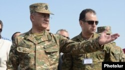 Armenia - Defense Minister Seyran Ohanian (L) and Vigen Sargsian, the chief of the presidential staff, inspect Armenian troops, 11Sep2015.