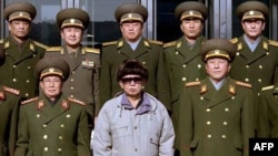 North Korean leader Kim Jong-Il (front row, center) with Ministry of People's Security officials at an undisclosed location