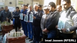 Iraqis mourn Muhannad Muhammad, a journalist killed in an explosion in Baghdad in December.