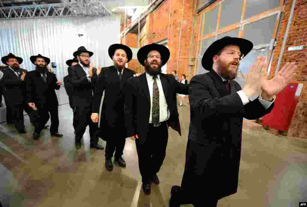 Jews sing and dance as they celebrate the handover of the Schneerson library at the Jewish Museum and Tolerance Center in Moscow on June 13. The library's Jewish archive has been the subject of a long-running dispute between Russia and the United States. (AFP/Yuri Kadobnov)