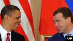 Barack Obama and Dmitry Medvedev are all smiles as they sign a nuclear disarmament treaty in Prague.