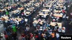 Мюнхенде мигранттар үчүн уюштурулган жай. Сентябрь, 2015-жыл.