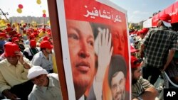 "File photo:Hezbollah leader Sheik Hassan Nasrallah and Venezuela's President Hugo Chavez, top, during a Hezbollah ""victory over Israel"" rally, in Beirut's bombed-out suburbs, Lebanon, Friday, Sept. 22, 2006."