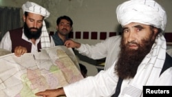 FILE: The Haqqani network is named after Jalaluddin Haqqani (R).