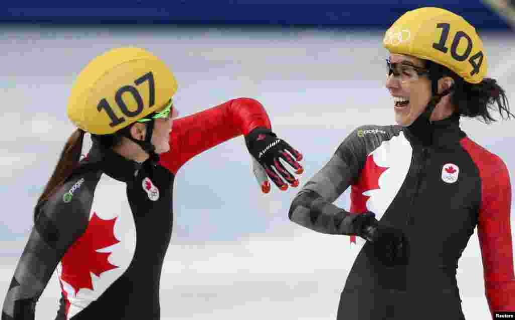 Second-placed team Canada's Valerie Maltais (left) and Marie-Eve Drolet laugh after the women's 3,000-meter short-track speed-skating relay final, won by South Korea. (Reuters/Lucy Nicholson)