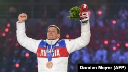 Russian gold-medalist Aleksandr Legkov celebrates on the podium during the men's cross-country skiing 50-kilometer mass-start free victory ceremony at the Sochi Winter Olympics in February 2014.