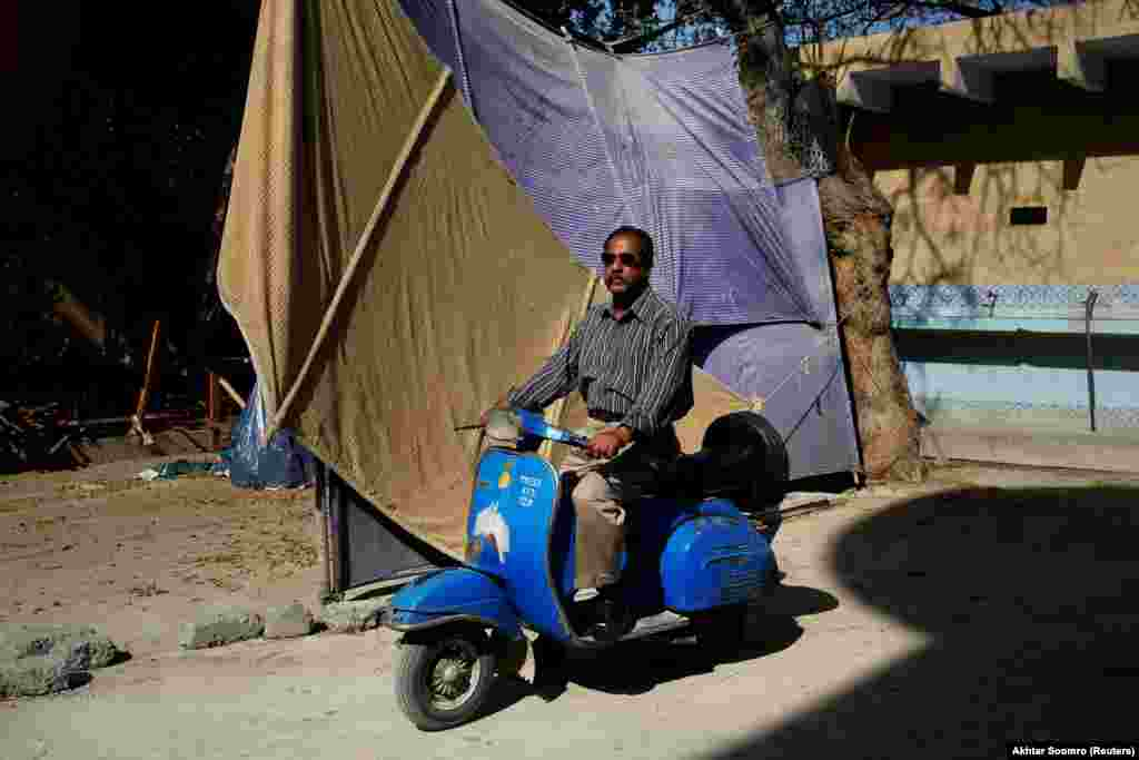 "Journalist Nazeer Udding Siddiqui, 58, poses for a photograph with his 1979 Vespa in Karachi. ""For me, people who own Vespas are very honorable people who still keep this tradition alive,"" he told Reuters."