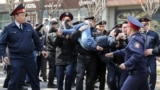KAZAKHSTAN -- Police officers detain anti-government protesters during a rally in Almaty, Kazakhstan March 22, 2019.
