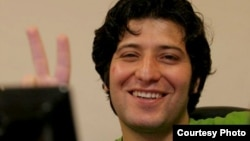 File photo: Iranian journalist Sasan Aghaei.