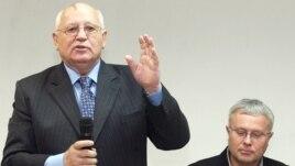 Gorbachev and Lebedev speaking in 2007