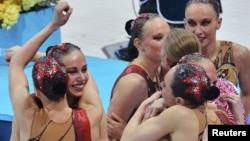 Russia's synchronized swimmers celebrate winning the gold medal.