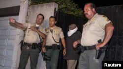 "Mark Basseley Youssef (second from right), the man thought to be behind the controversial smear video ""Innocence Of Muslims,"" is led from his southern California home by sheriffs in September."
