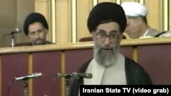"Ali Khamenei during the 1989 meeting where he was selected to succeed Ayatollah Khomeini: ""I am not qualified"" to be Supreme Leader. Video grab. FILE PHOTO"