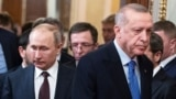 Russian President Vladimir Putin (left) and Turkish President Recep Tayyip Erdogan: The newly assertive role of Turkey in the South Caucasus is a daunting factor in a region that the Kremlin clearly still considers Russia's backyard.
