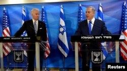 جو بایدن (چپ) در کنار بنیامین نتانیاهو در اسرائیل
