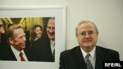 Pavel Pechacek poses next to a picture of former Czech President Vaclav Havel at RFE/RL headquarters