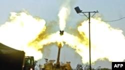 Israeli artillery fires toward the Gaza Strip from the Israeli side of the Israel-Gaza border on January 4.