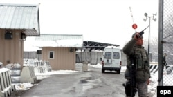 A U.S. soldier guards the main checkpoint at the Manas air base in Kyrgyzstan.