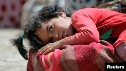 Дитина з родини єзидів, які після наступу ісламістів, змушені були втікати, 10 серпня