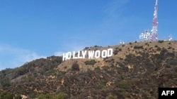 U.S. -- The freshly painted Hollywood sign is seen atop the Hollywood Hills following a press conference to announce the completion of the famous landmark's major makeover in Hollywood, California, 04Dec2012