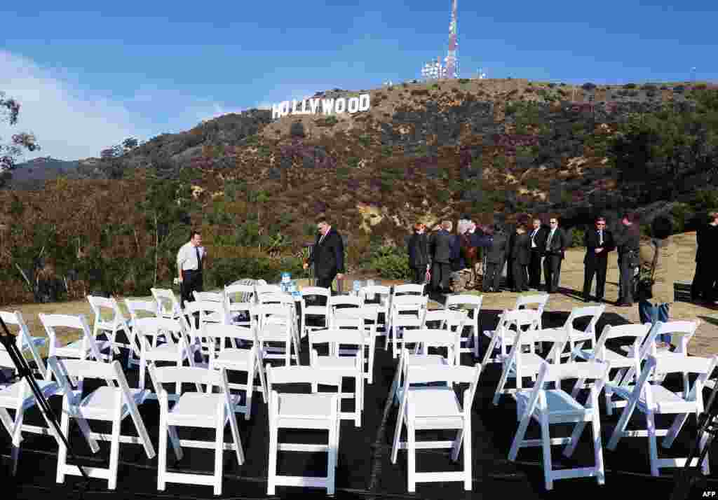 The freshly painted Hollywood sign is seen atop the Hollywood Hills following a press conference to announce the completion of the famous landmark's major makeover. Almost 1,400 liters of paint and primer were used to provide the iconic sign with its most extensive refurbishment in almost 35 years in advance of its 90th birthday next year. (AFP/Robyn Beck)