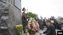 Acting Moldovan President Mihai Ghimpu lays a bouquet of flowers at a memorial for victims of the Soviet occupation in Chisinau on June 28.