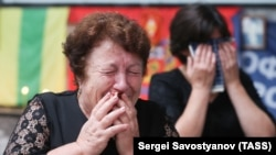 Women attend a ceremony to mark the 13th anniversary of a fatal school hostage-taking attack in southern Russian town of Beslan, on September 1, 2017.