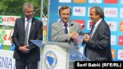 Michel Platini (right) attends the opening of a soccer training center in Bosnia