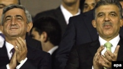 Turkey -- President Abdullah Gul (R) with his Armenian counterpart Serzh Sarkisian at Turkey vs Armenia FIFA 2010 World Cup group match in Bursa, 14Oct2009