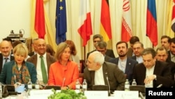 EU foreign policy chief Federica Mogherini (center left) and Iran's Foreign Minister Mohammad Javad Zarif (center right) hold talks in Vienna on July 6.