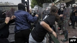 Greek protesters clashed with riot police protecting the Greek Parliament in Athens on October 9.