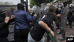 Protesters clash with riot police in Athens on October 9.