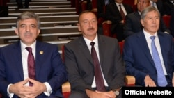 Turkish President Abdullah Gul (left), Azerbaijani President Ilham Aliyev (center), and Kyrgyz President Almazbek Atambaev attend a concert in Baku on August 15.
