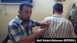 الكوت آثار الضرب على جسم احد الصحفيين