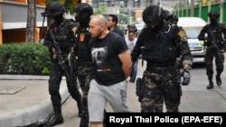 Sergei Medvedev (center) is shown being arrested by Thai special forces in Bangkok on February 9, 2018.