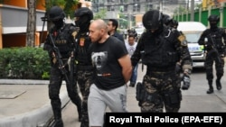 Infraud co-founder and administrator Sergei Medvedev, shown here at his arrest in Thailand in February 2018, pleaded guilty to similar charges last month.