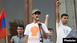 "Armenia - ""Electric Yerevan"" protest leaders Narek Ayvazian (L) and Davit Sanasarian (R) hold a rally in Liberty Square, Yerevan, 10Jul2015."