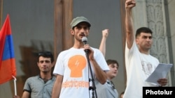 """Electric Yerevan"" protest leaders Narek Ayvazian (left) and Davit Sanasarian (right) hold a rally in Liberty Square in Yerevan on July 10. ""We continue our fight. We will be successful,"" says Sanasarian."
