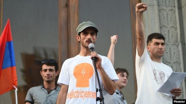 "Armenia - ""Electric Yerevan"" protest leaders Narek Ayvazian (L) and Davit Sanasarian (R) hold a rally in Liberty Square, Yerevan, 10Jul2015."