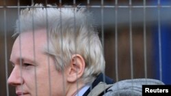 WikiLeaks founder Julian Assange arrives at Belmarsh Magistrates Court in southeast London on January 11.