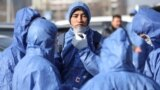 Kazakhstan - Specialists wearing protective gear sanitize public facilities to prevent the spread of coronavirus disease (COVID-19) in Almaty, Kazakhstan March 27, 2020. REUTERS/Pavel Mikheyev