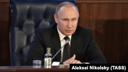 Russian President Vladimir Putin speaks at an extended Defense Ministry meeting in Moscow on December 22.